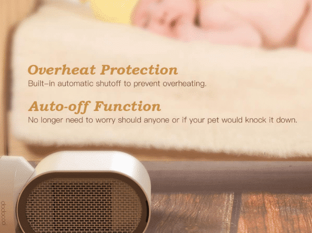 picture of a baby sleeping beside a small space heater