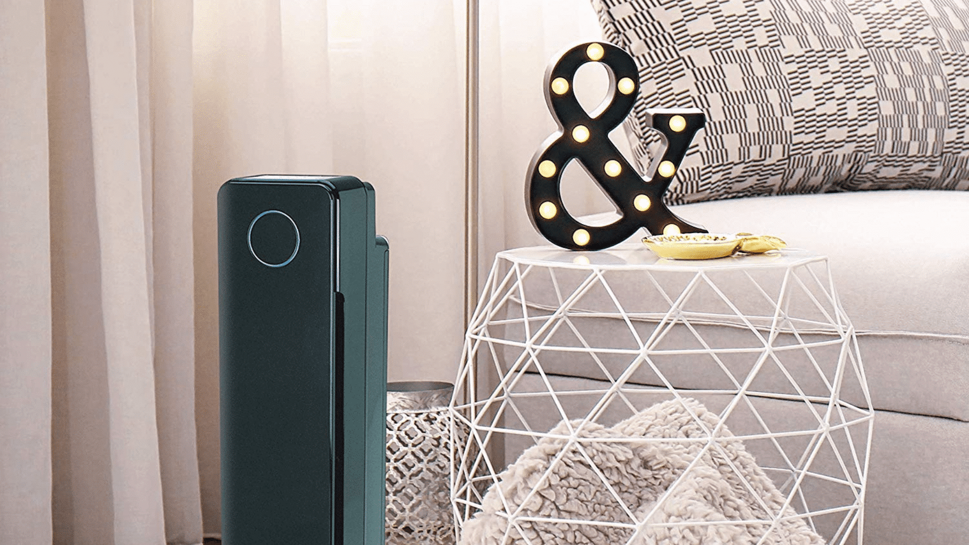Image of GermGuardian AC5350B staged beside geometric night stand and & sign decor