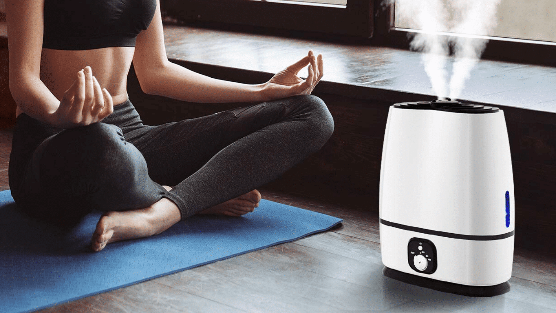 image over everlasting comfort ultrasonic cool mist humidifier beside woman doing yoga