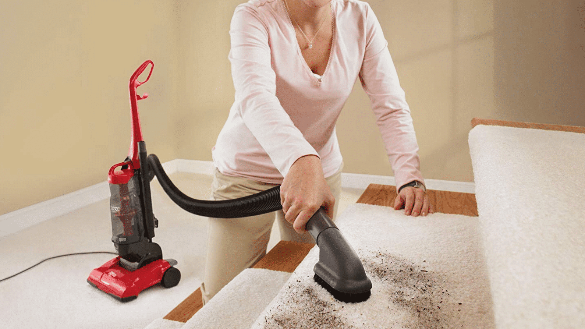 picture of Dirt Devil Vacuum Cleaner Breeze Cyclonic Corded Bagless Upright Vacuum UD70105 being used to clean carpet