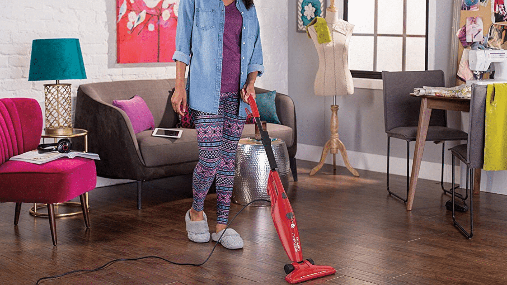 image of dirt devil simpli stik vacuuum being used to clean wood floor