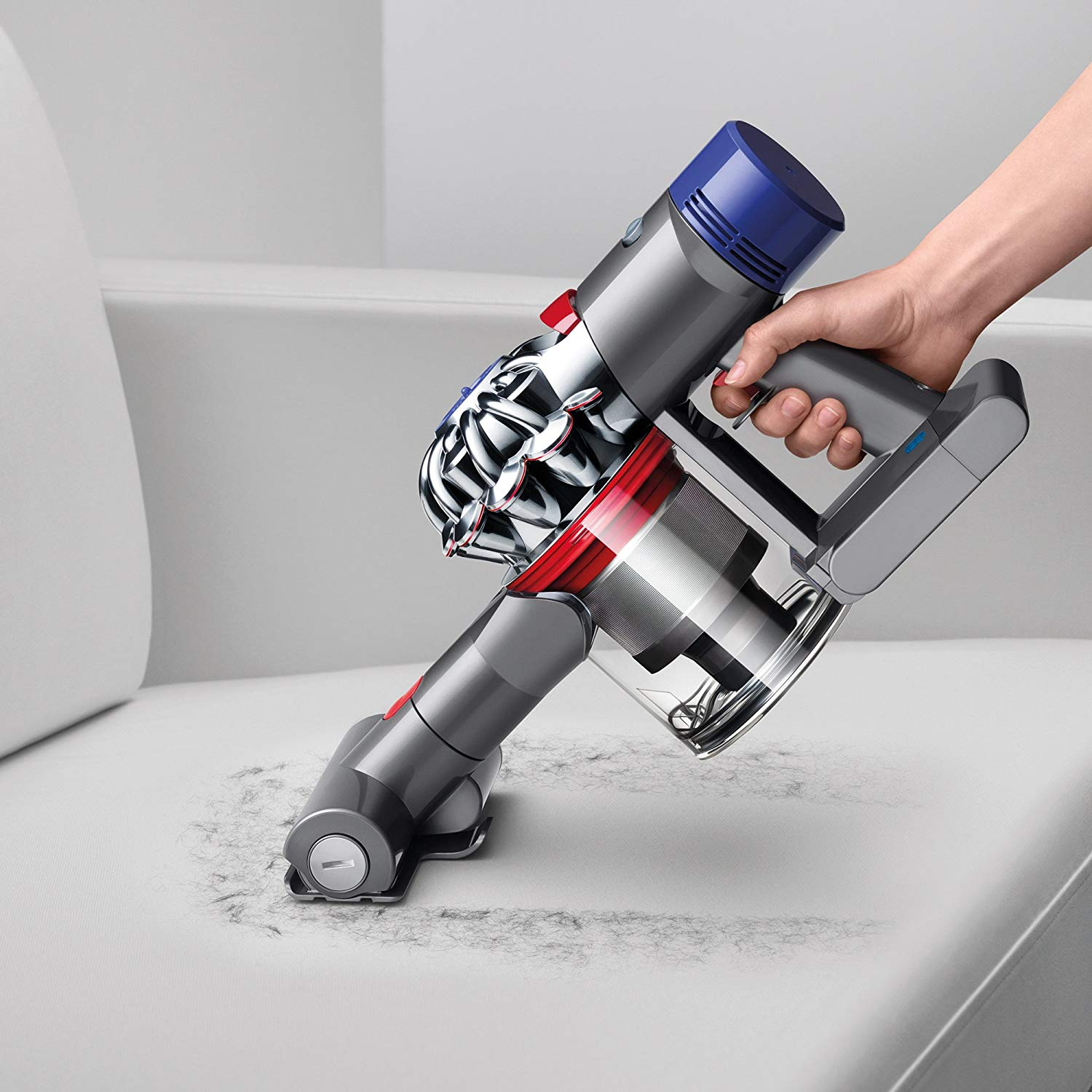 picture of dyson v7 animal cordless stick vacuum cleaning grey couch