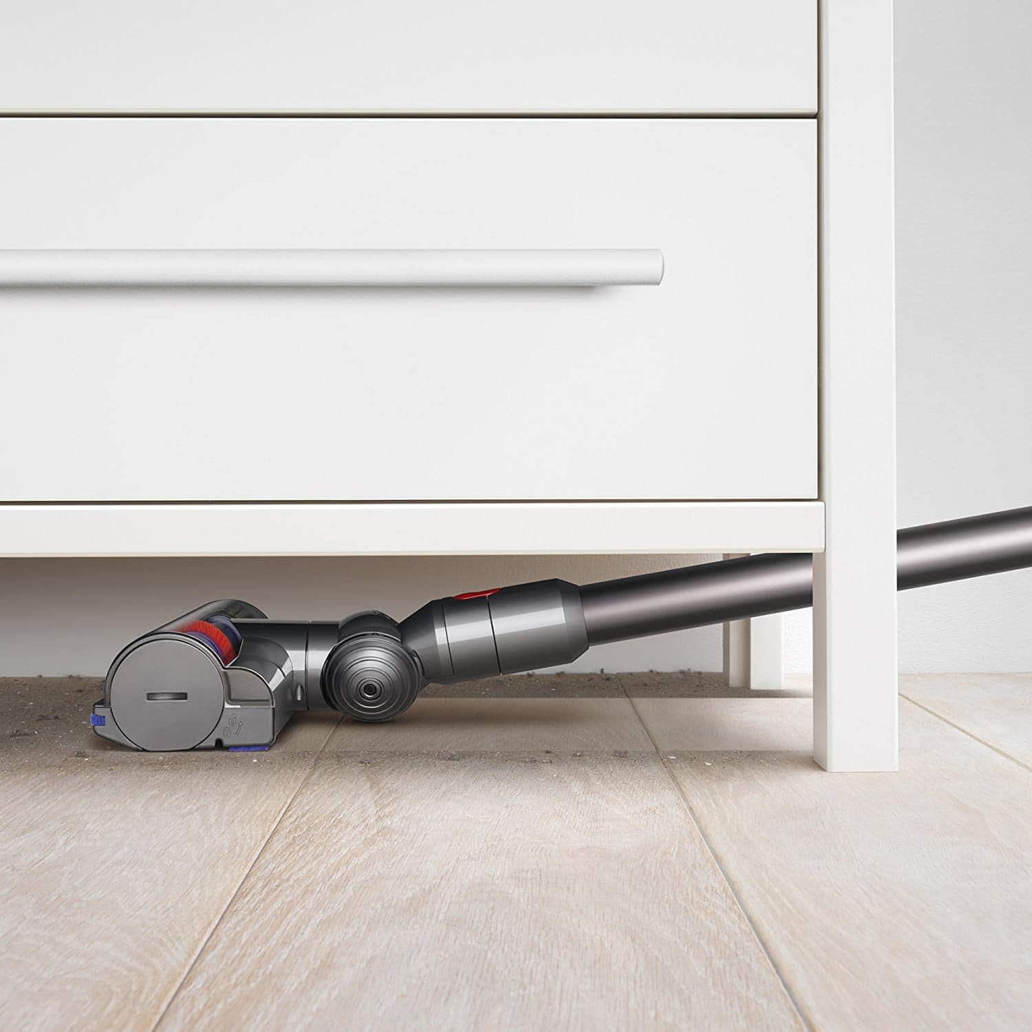 using Dyson V7 to clean under cabinet