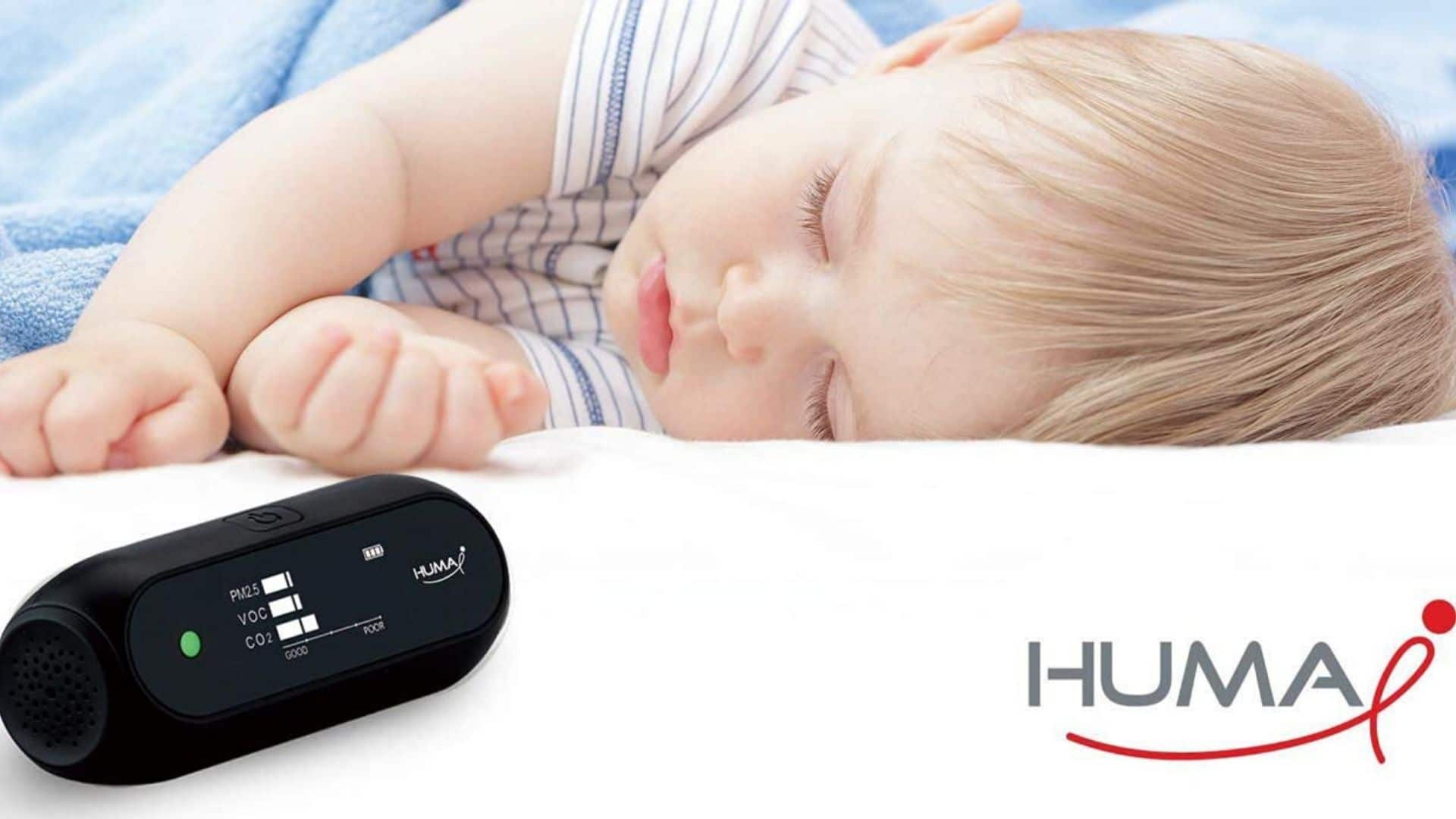 picture of baby sleeping beside Humai i HI 150 Advanced Portable Air Quality Monitor