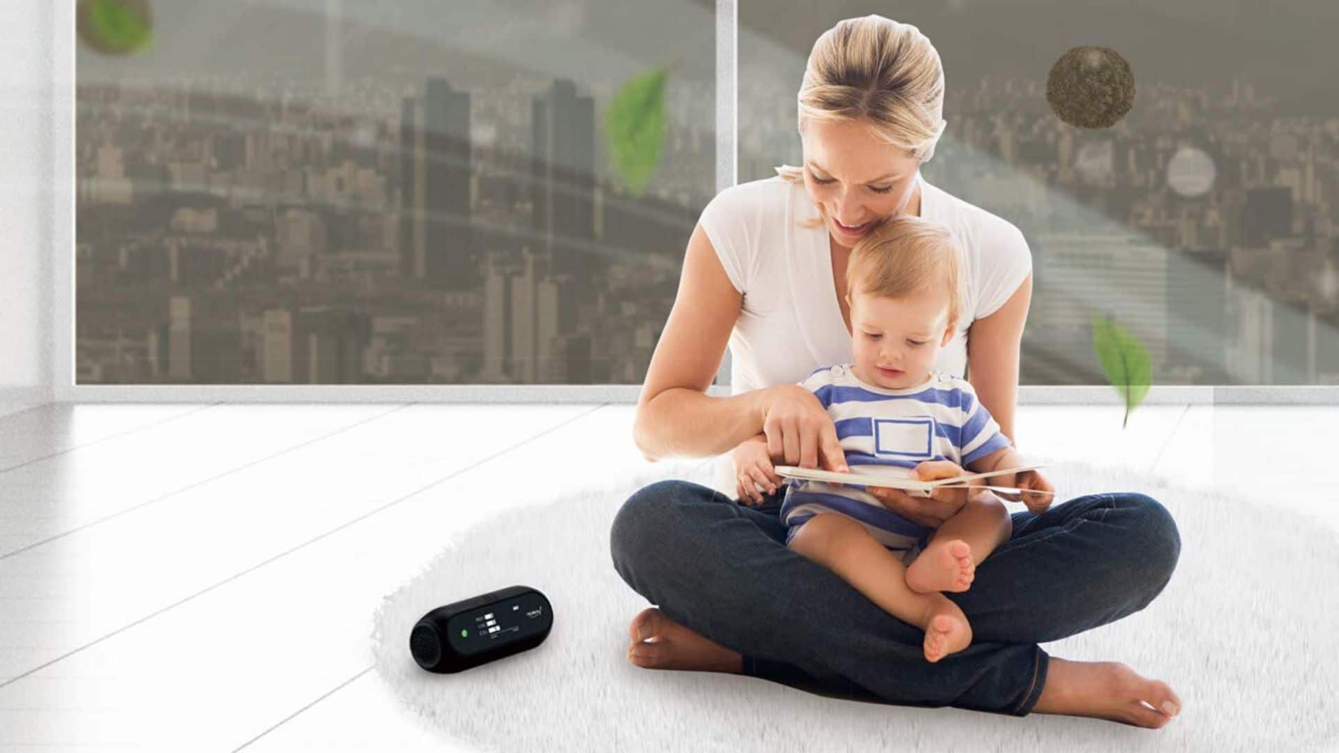 picture of woman holding baby beside Humai i HI 150 Advanced Portable Air Quality Monitor