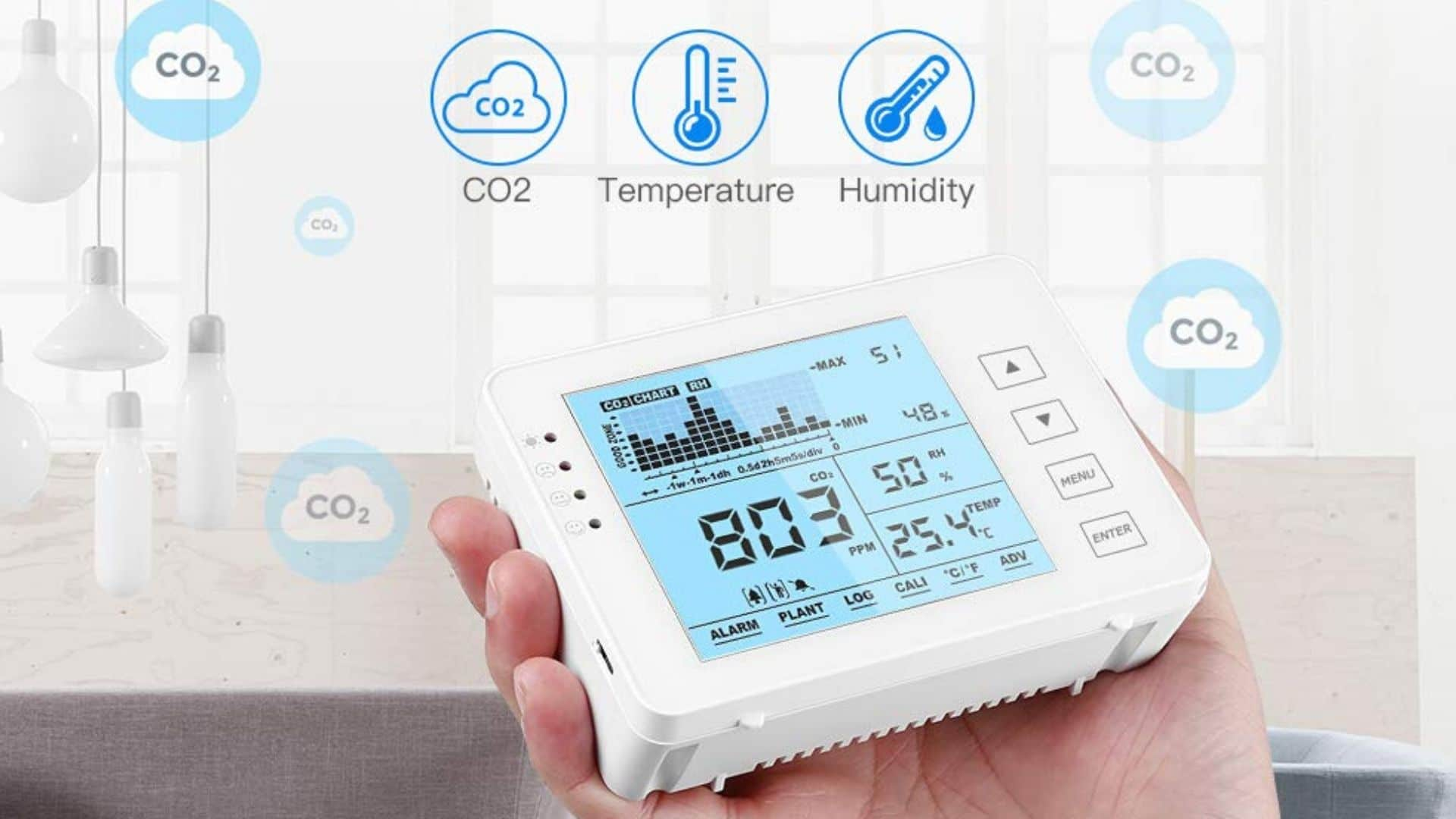 picture of person holding seesil air quality monitor with features