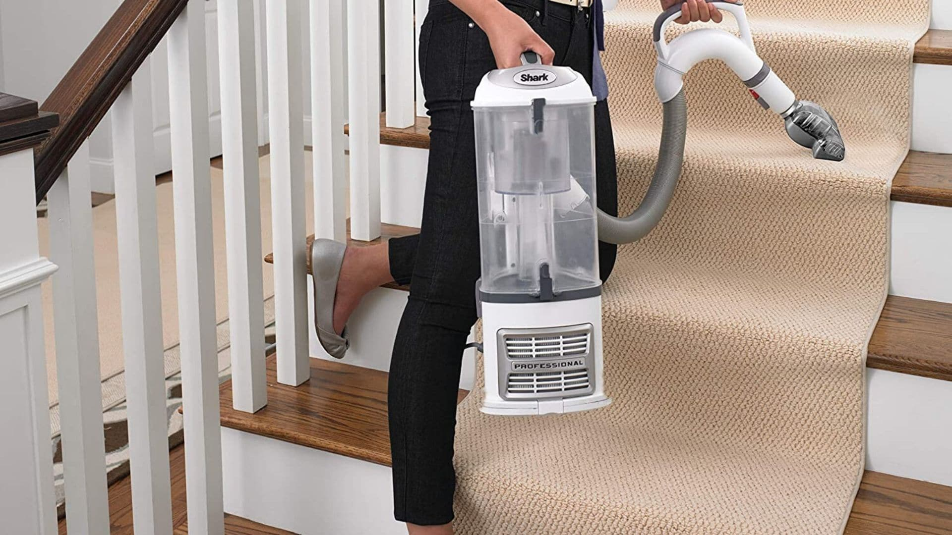 woman kneeling and holding shark navigator lift away professional nv356e to clean stairs