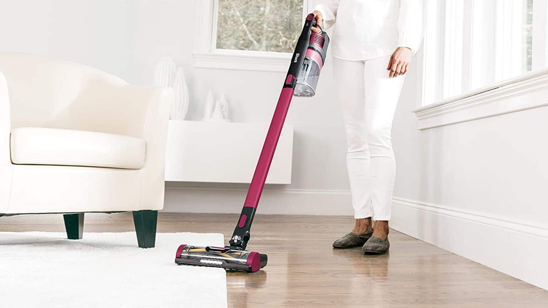 woman using shark rocket pet pro with self cleaning brushroll to clean hardwood floor