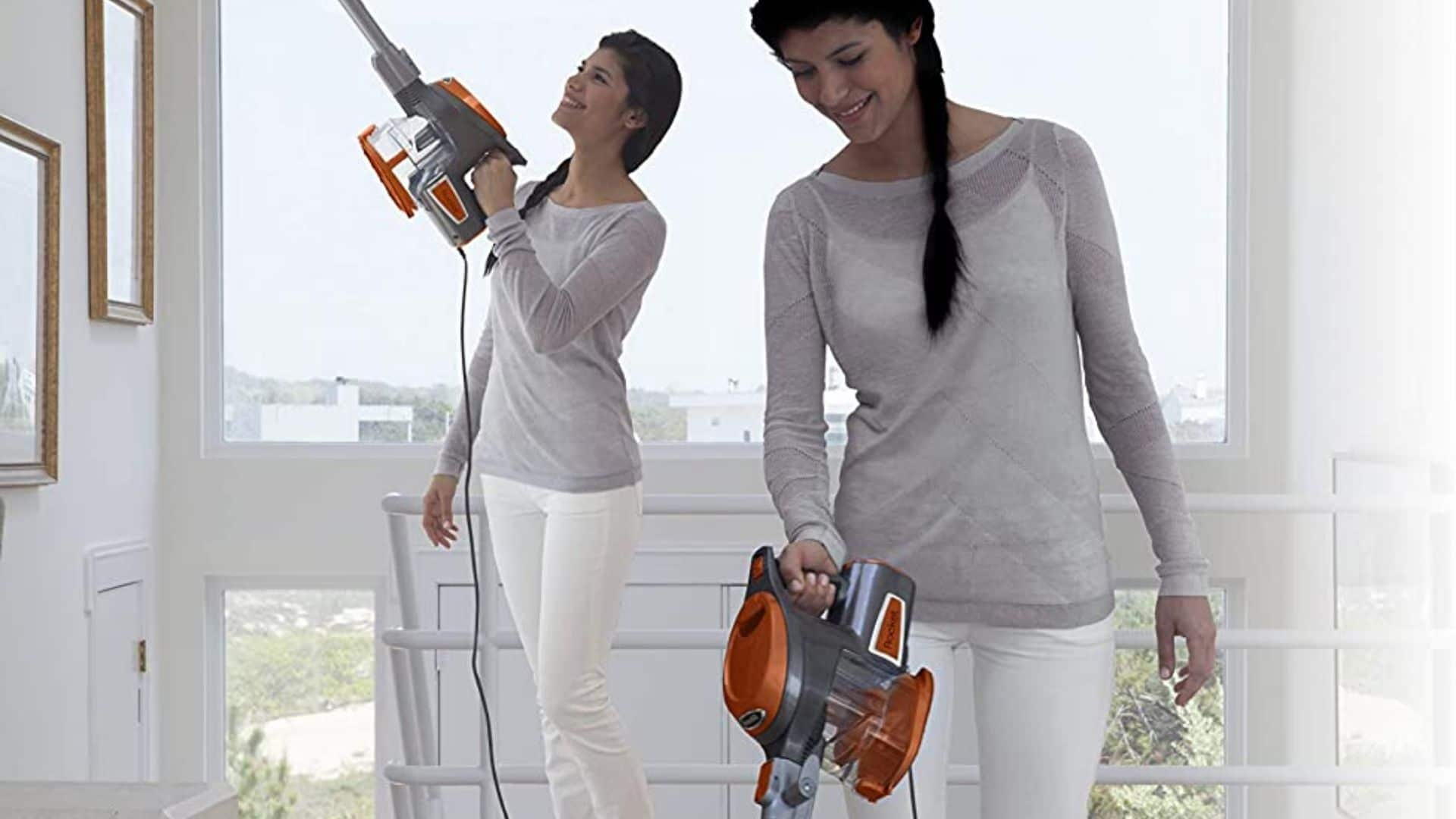 picture of woman using HV301 to vacuum floor and hand vac for ceiling