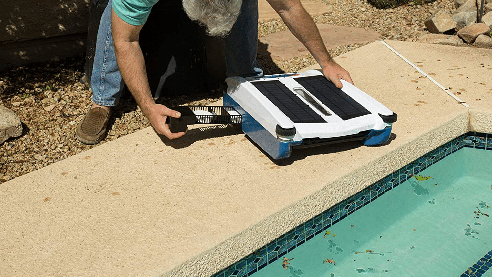 woman removing filter from Solar-Breeze NX2 Intelligent Solar Robot Pool Skimmer on Edge of Pool