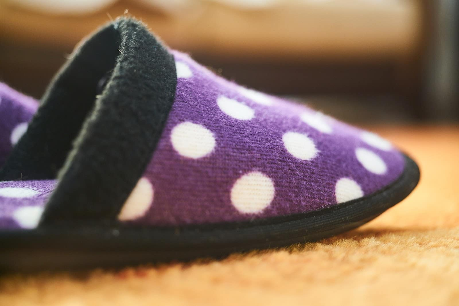 picture of purple polka dotted slipped on carpet