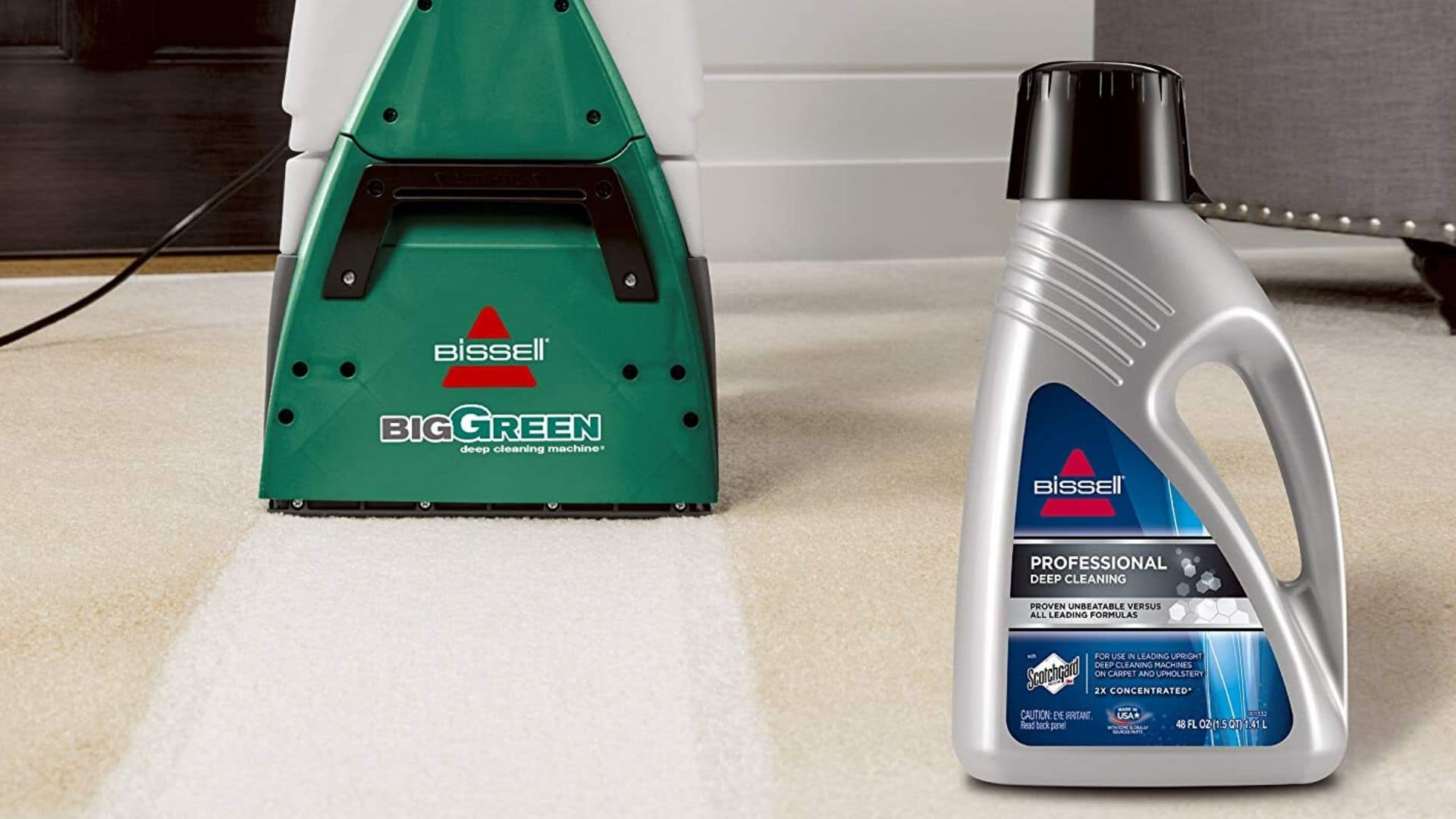 Bissell Big Green 86T3 Professional Carpet Cleaner beside cleaning solution