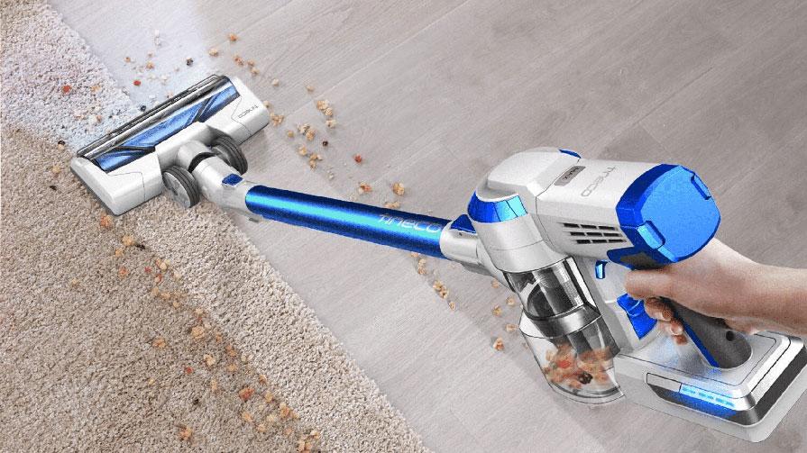 image of Cordless Vacuum Cleaner being used to clean wood floor