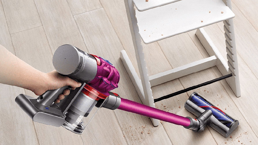 image of Dyson V7 Motorhead Cordless Vacuum Cleaner being used to clean wood floor