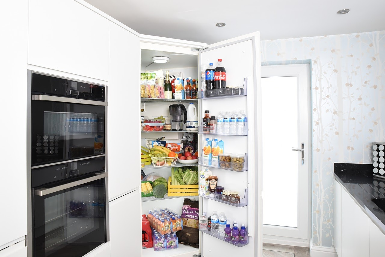 picture of open fridge full of food