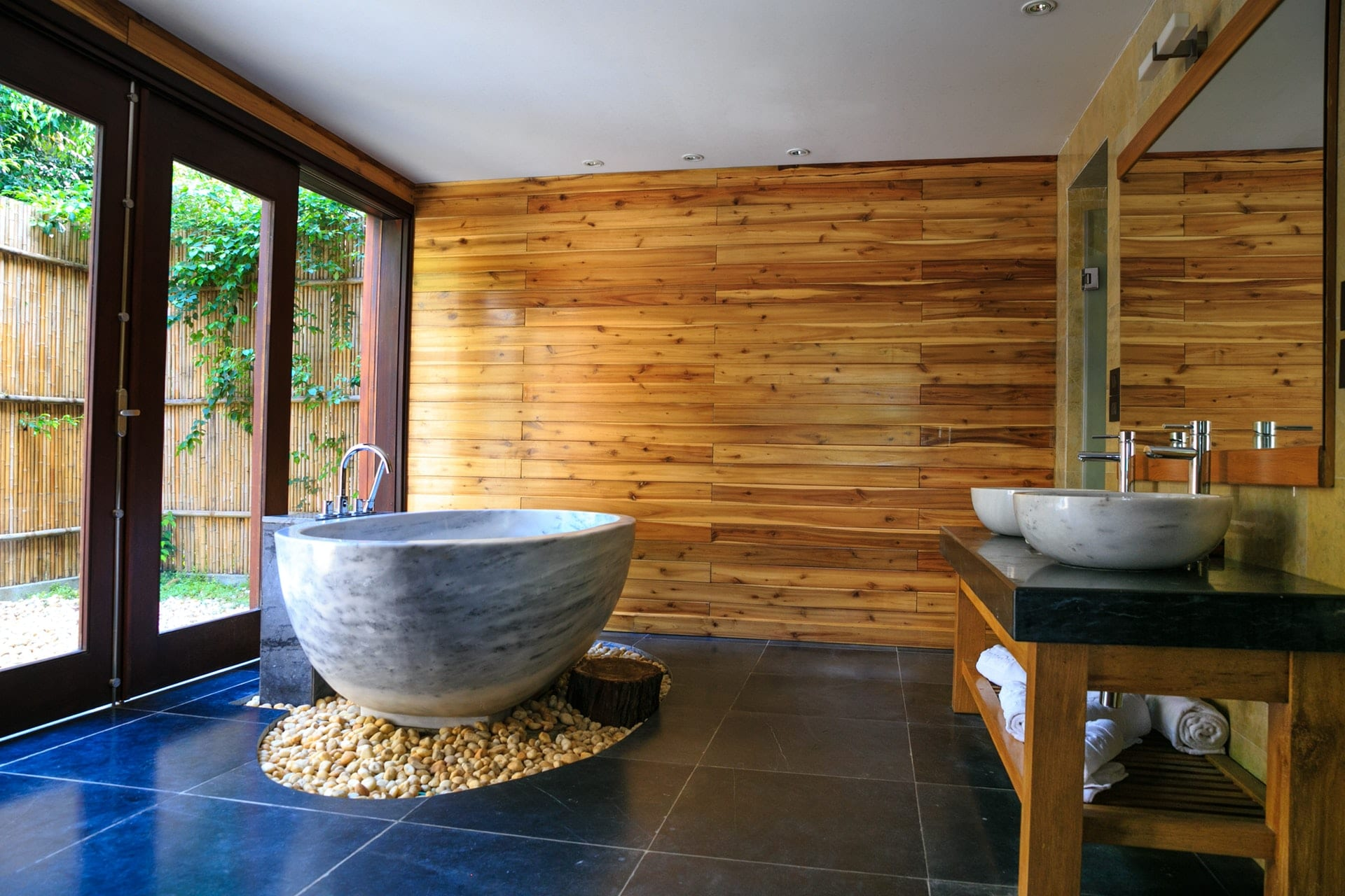 picture of spa bathroom with solo bathtub and wooden walls