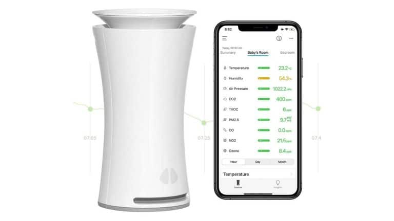 image of UHOO Indoor Air Quality Sensor beside phone with mobile app