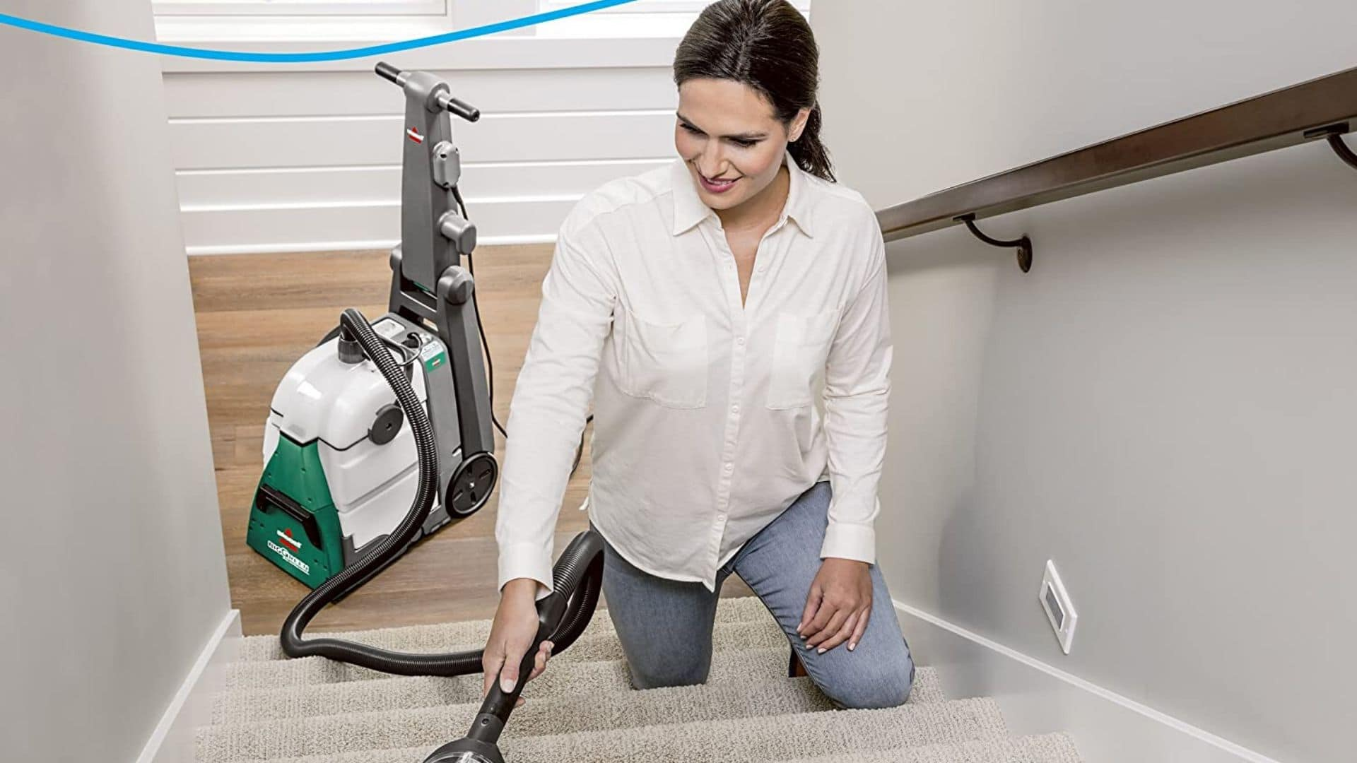 picture of woman cleaning carpet with bissell big green 86t3